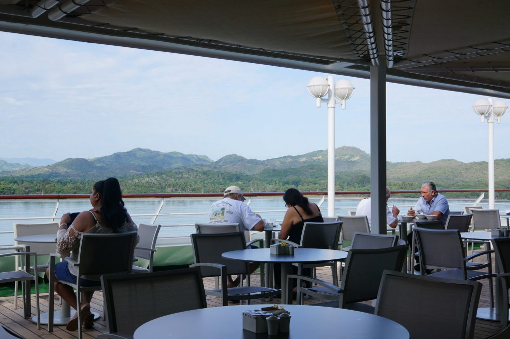 Dining on the stern of the Fathom Adonia with beautiful views of the mountains surround Amber Cove, near Puerto Plata, DR
