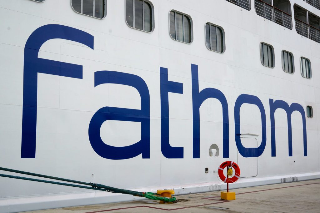 Fathom travel logo on the side of the Fathom Adonia cruise ship