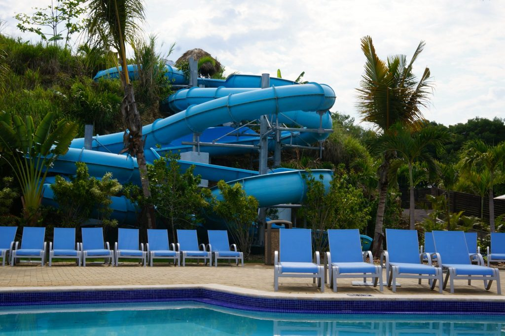 Amber Cove waterslide, pool, and lounge chairs