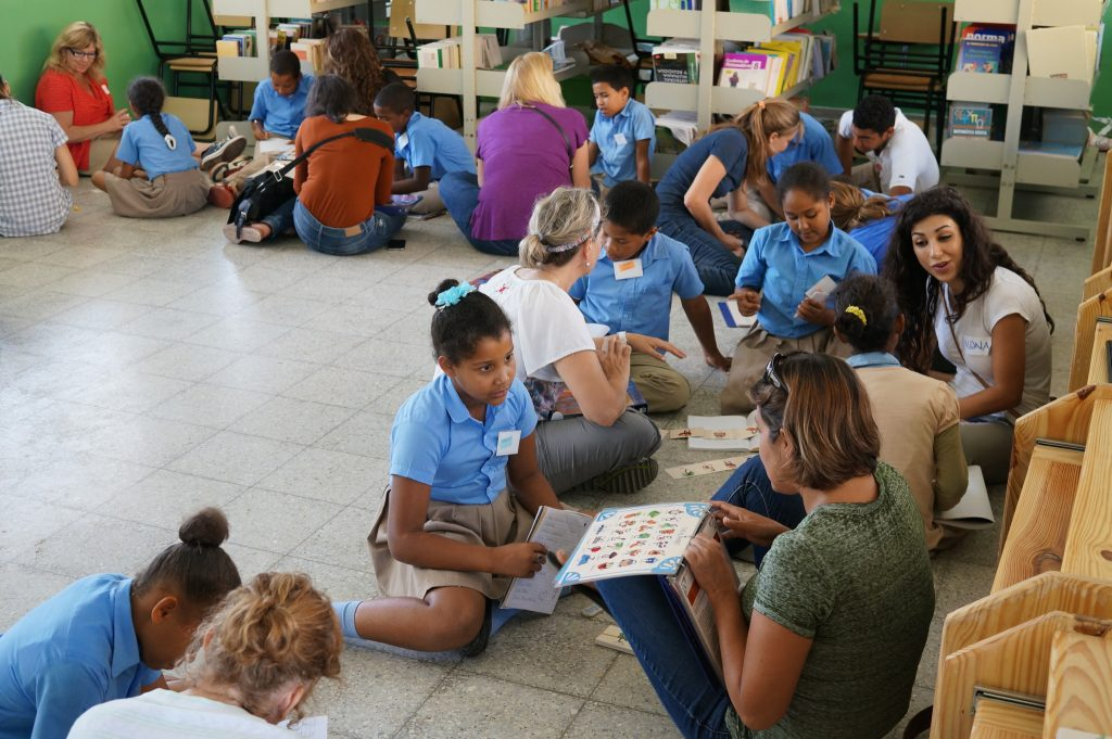 Teaching student english at a Puerto Plata school during Fathom travel to Dominican Republic