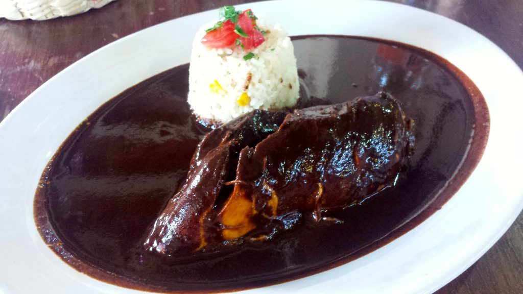 Mole Negro is the signature mole of Oaxaca and is made with hija santa leaves