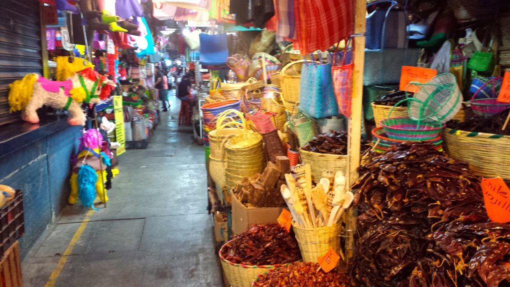 An aisle of spices and a piñata spotted at the Benito Juarez Market Oaxaca