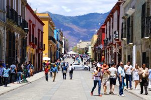 Oaxaca is a colonial city in Mexico with walkable streets and is surrounded by mountains