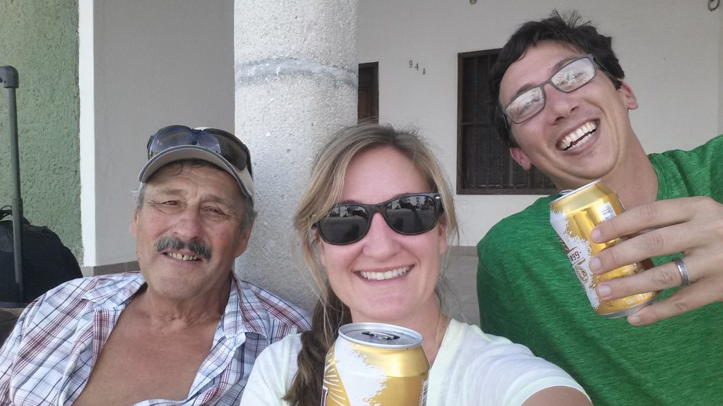 Drinking beers on the curb in Progreso Mexico