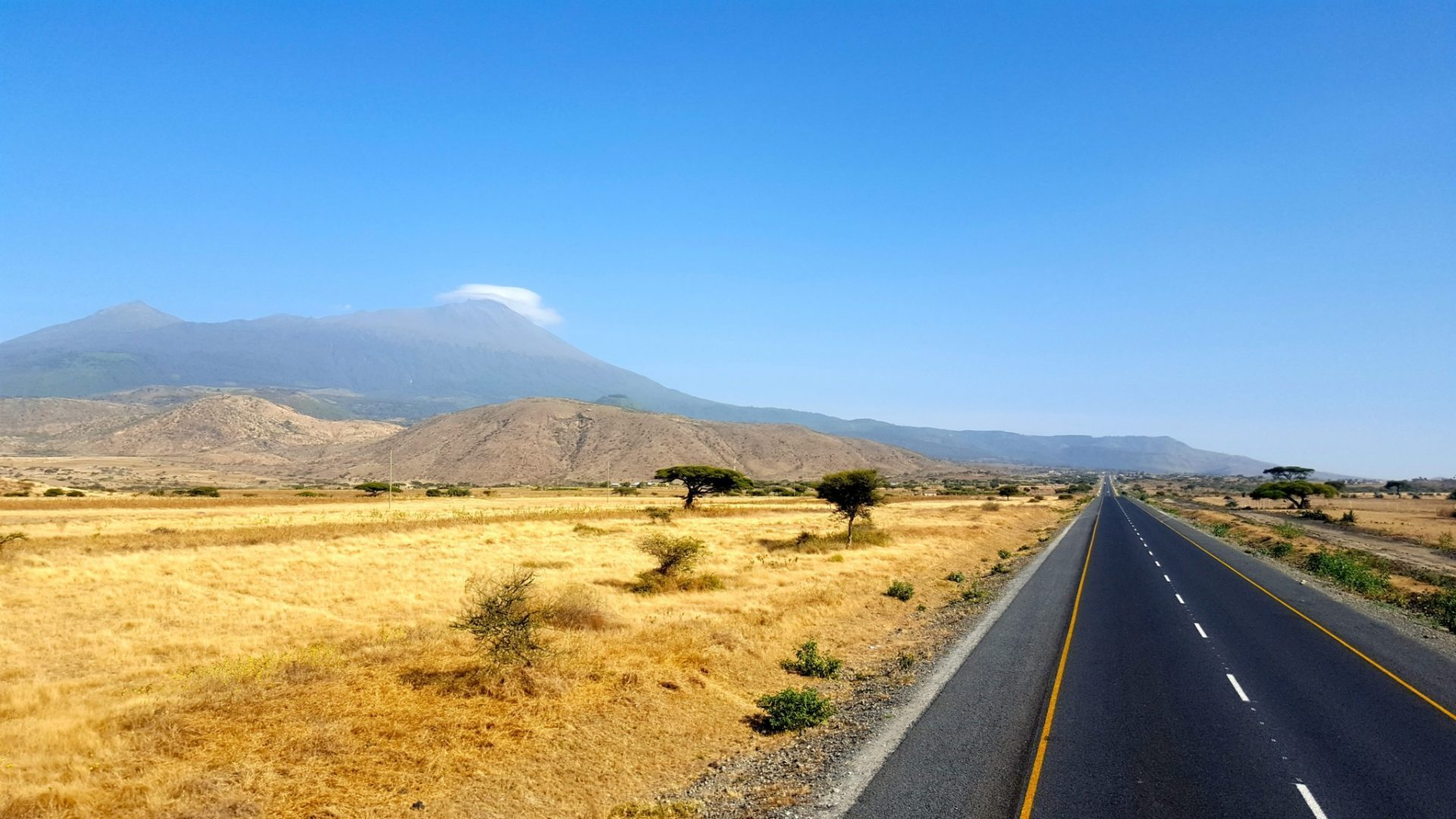 Road in Tanzania with Mount Meru in the background