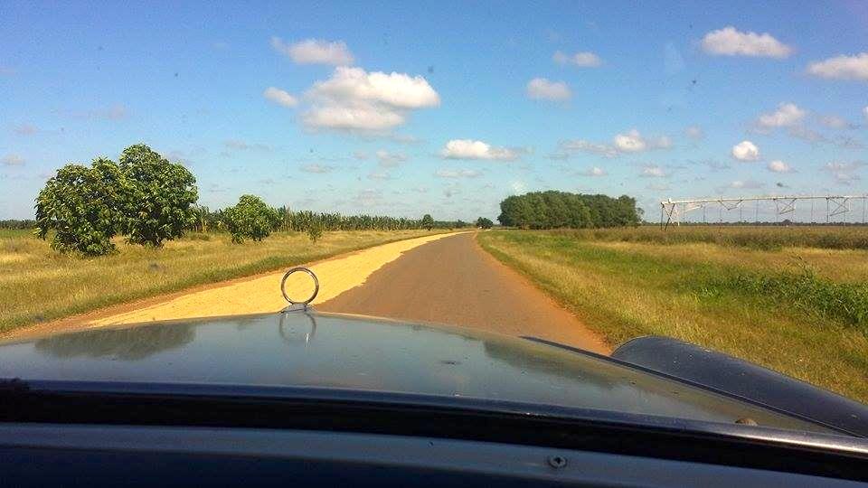 Classic car driving across Cuba countryside