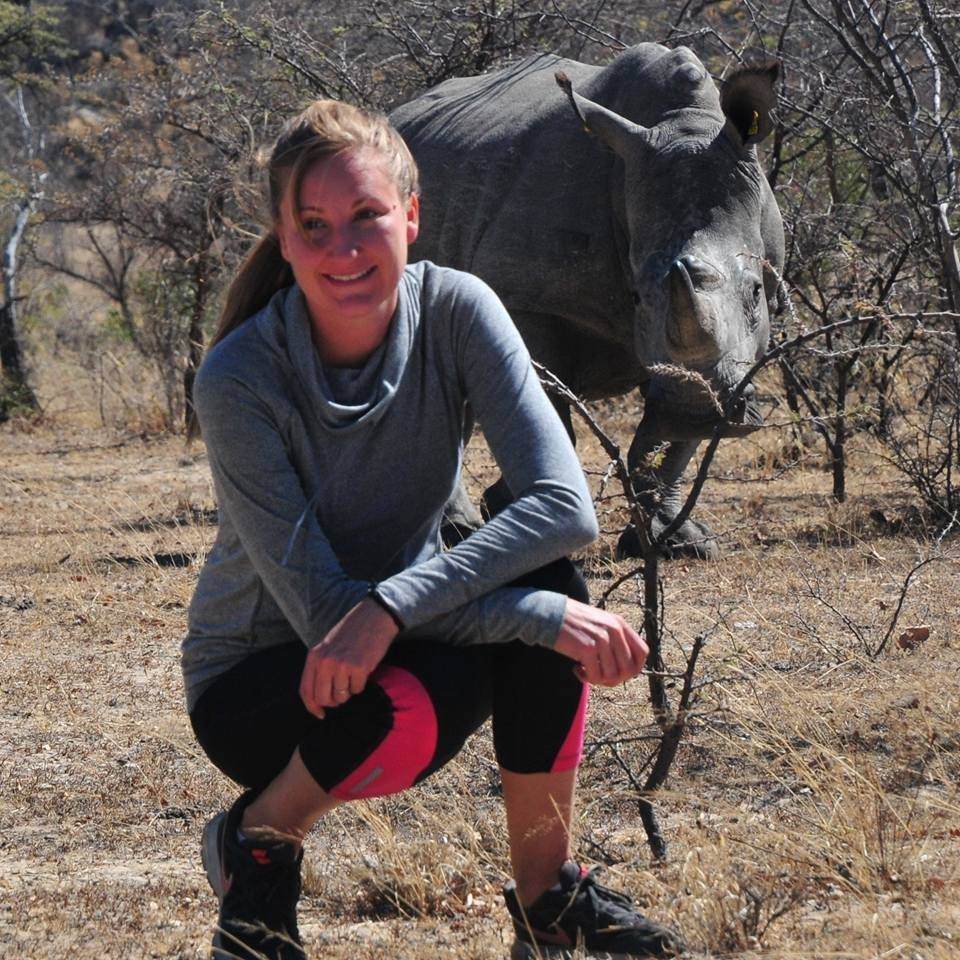 Posing with a rhino on a walking safari in Matobo National Park