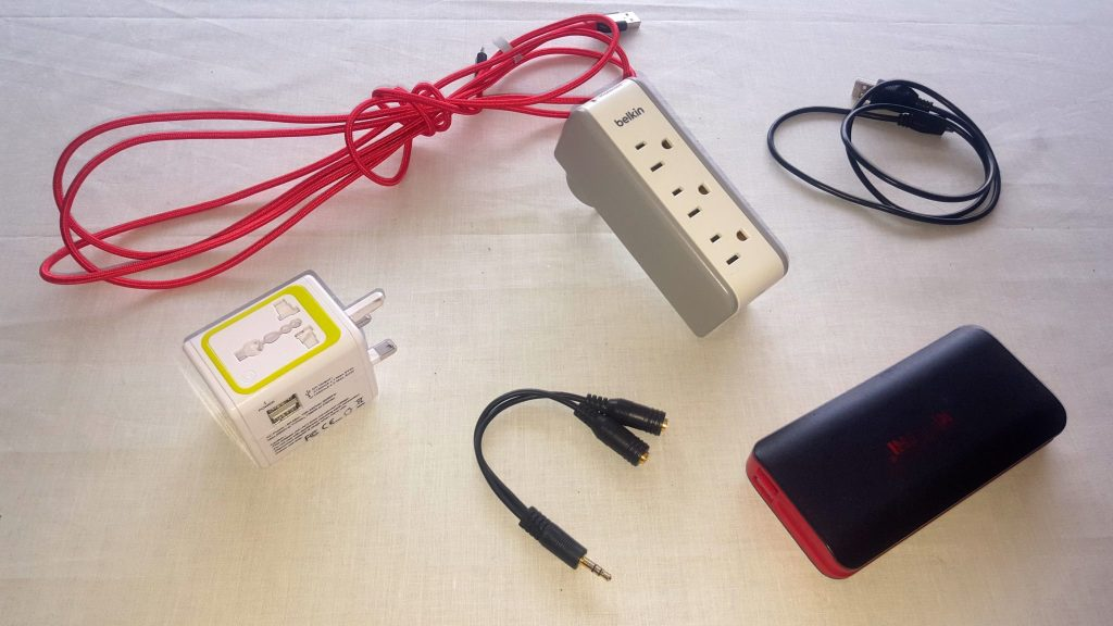 Travel cables travel pack list includes universal adapters, USB cords, surge protector, earphone splitter, and power bank