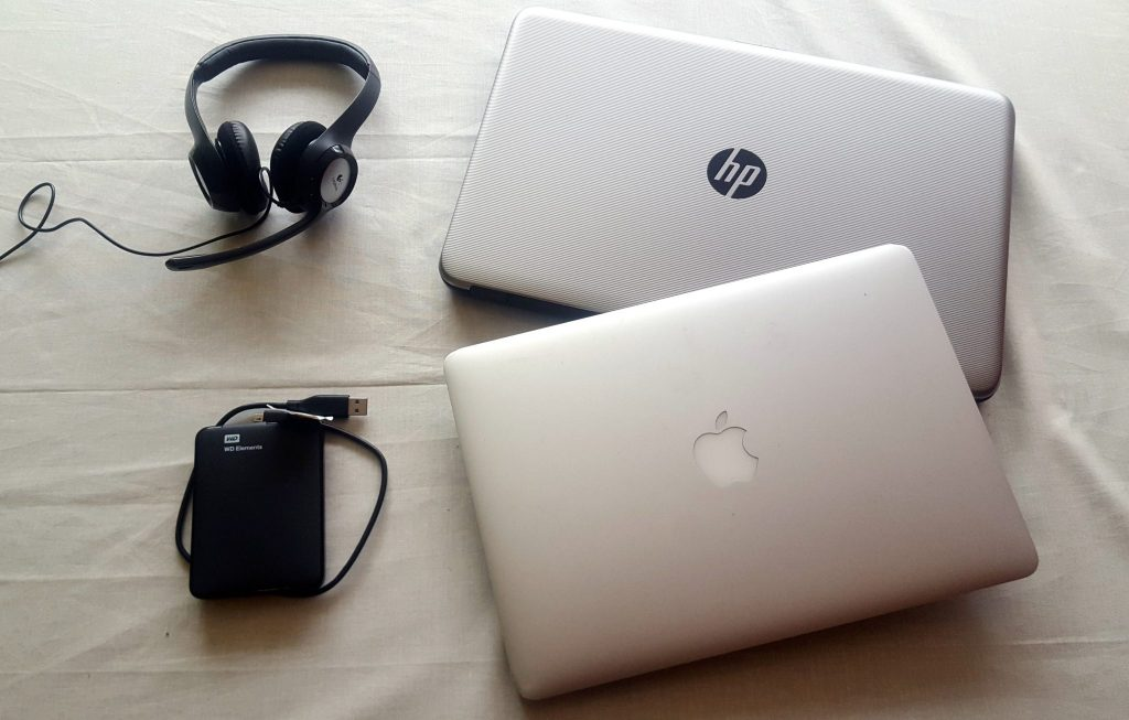 Electronics to pack for long term travel around the world include laptops, headset, and external hard drive.
