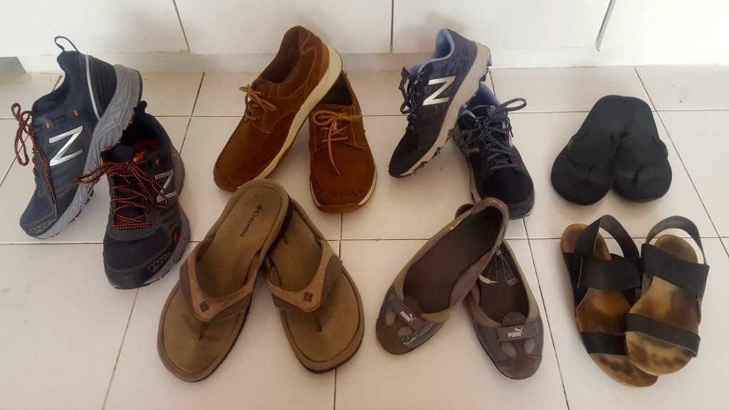 What Shoes to Pack for Travel Trip for men and women includes: trail running shoes, flip flops, boat shoes, and ballet flats