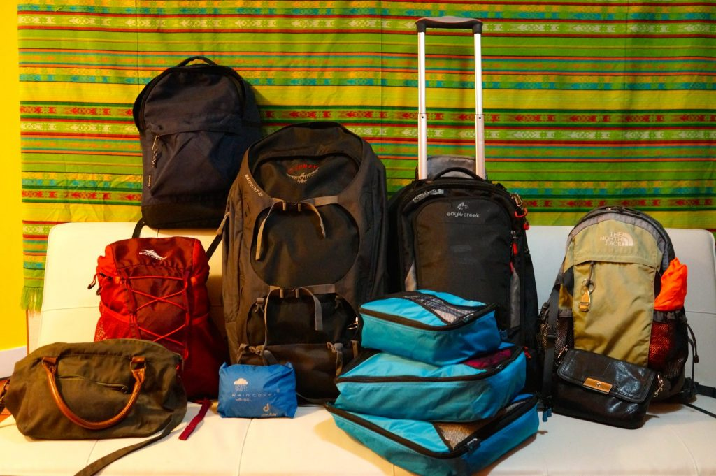 Travel luggage recommendations: backpack vs roller bag, packing cubes, day bags, smaller backpacks, rain covers, cross body bag, and more.