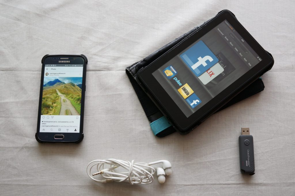Electronics travel pack list includes a kindle, mobile phone, ear phones, and more.