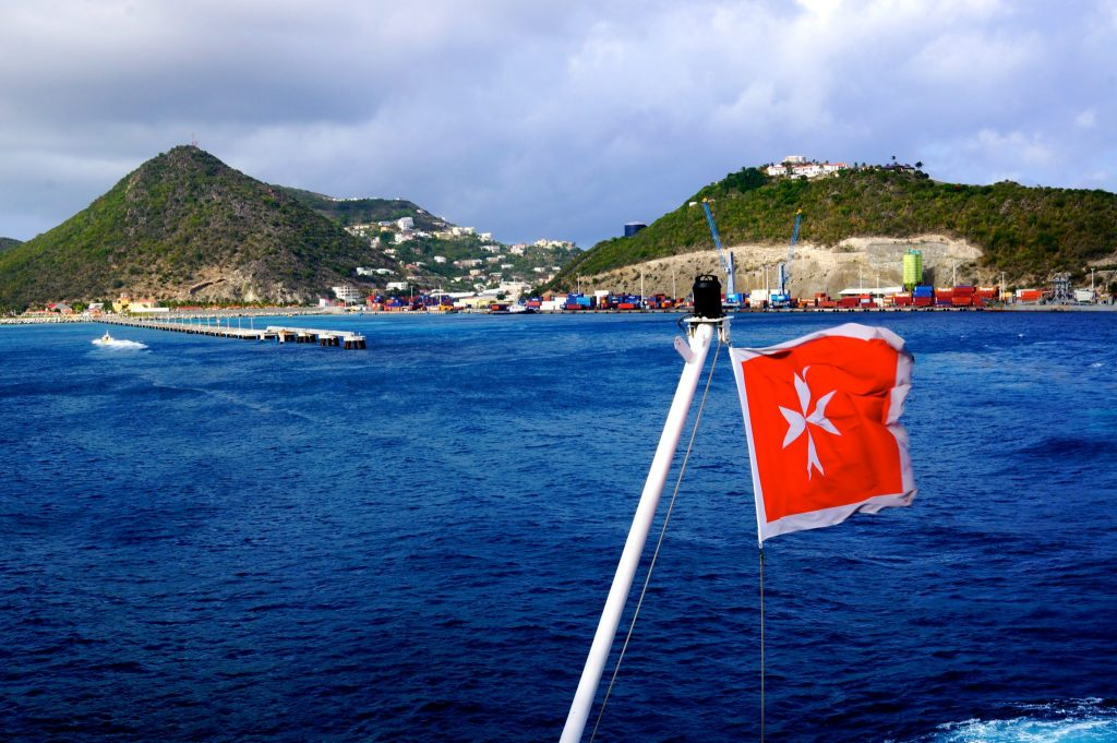 Pullmantur Monarch sailing under Malta flag as it leaves the port of St Maarten
