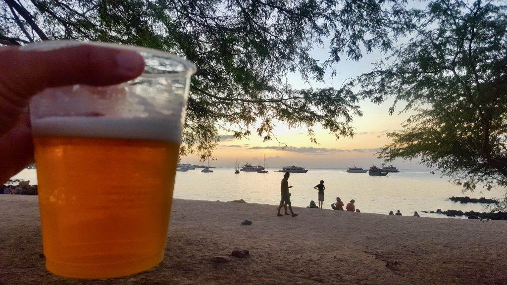 A beer on the beach in the Galapagos is a relaxing way to drink for cheap in the Galapagos