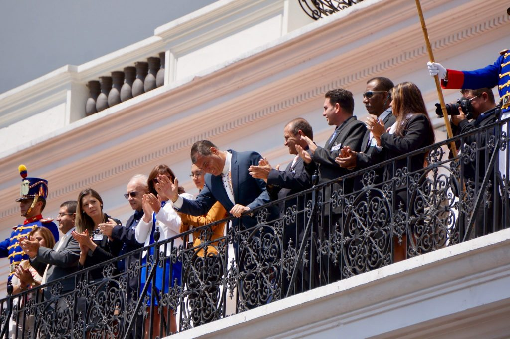 President of Ecuador greets the crowds gathered at Plaza Grande during the weekly Monday Changing of the Guards tradition