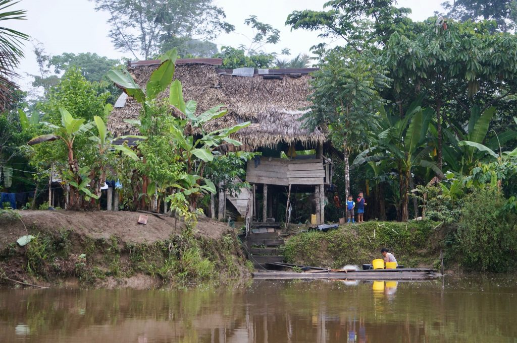 Napo River village and canoe