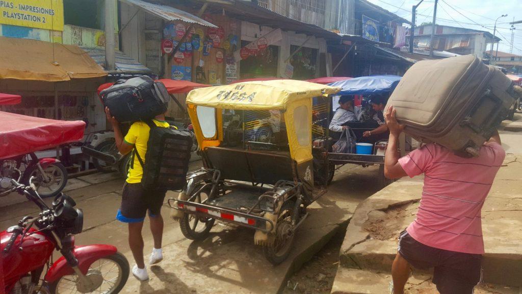 Loading luggage onto tuk tuks in Mazan Peru, as shortcut to the Amazon River