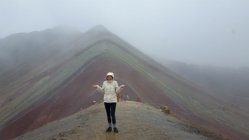 Woman on Rainbow Mountain in the Snow Showing Why Not To Hike Rainbow Mountain Peru