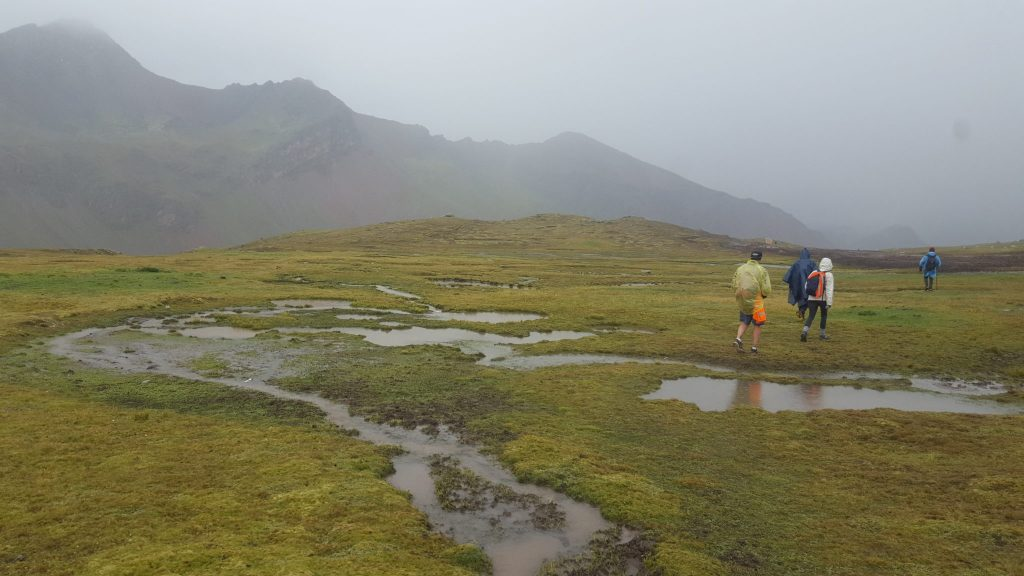 Rainbow Mountain trail puddles in the rain Peru