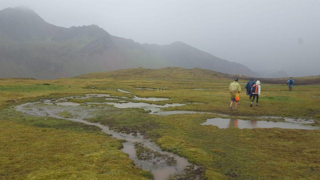 Rainbow Mountain trail puddles in the rain Peru