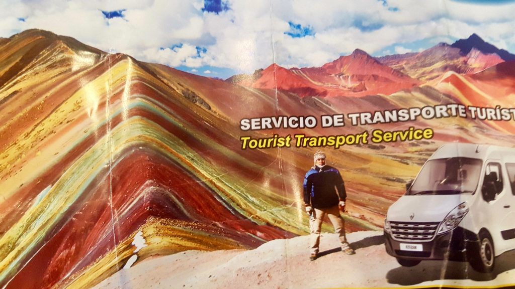Rainbow Mountain Peru brochure showing a van on the mountain