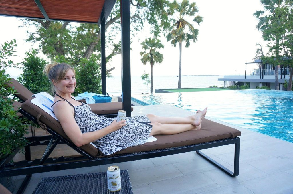 Heather drinking beer at infinity pool from a hotel deal from searching the best hotel websites