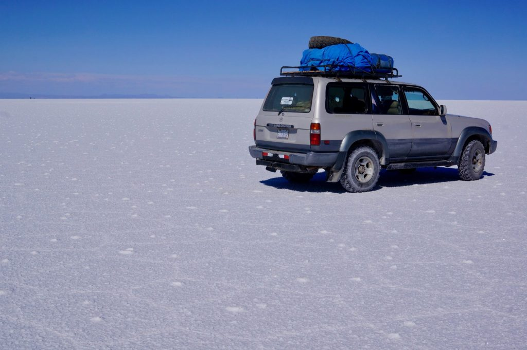 Salty Desert Aventours Land Rover on Salar de Uyuni salt flat tour