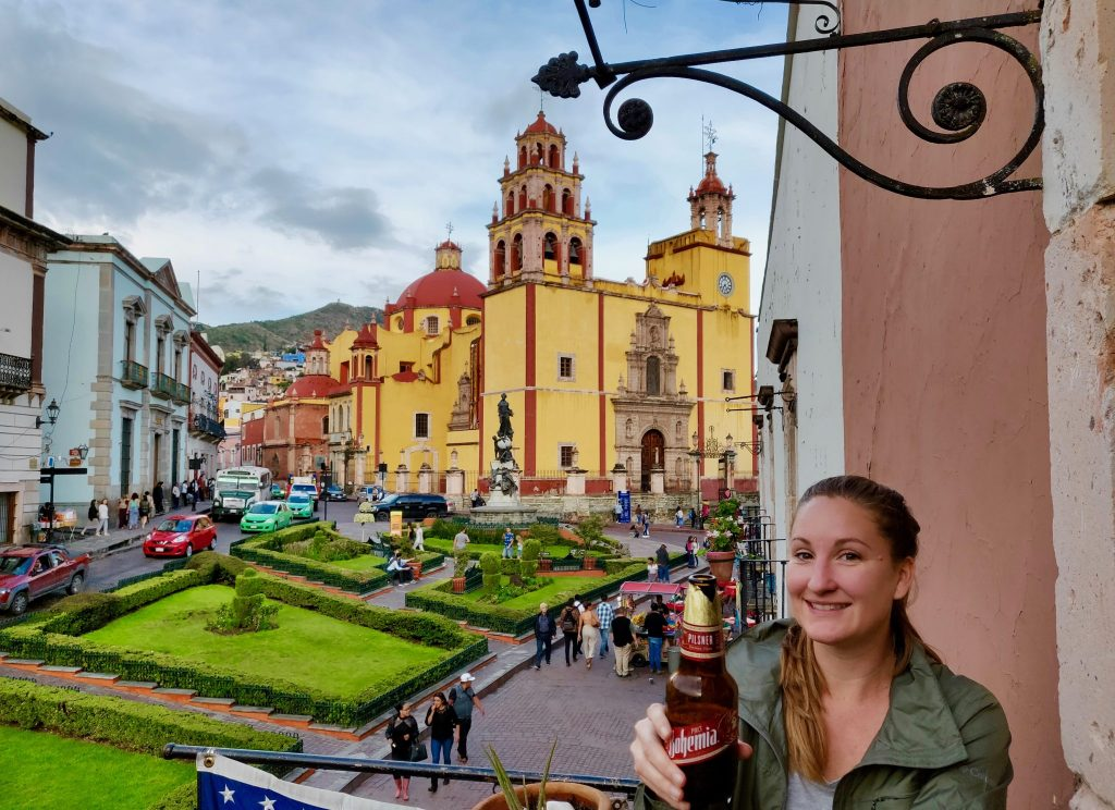 Drinking a beer at La Taberna de Sancho on Plaza la Paz in front of the basilica in Guanajuato Mexico