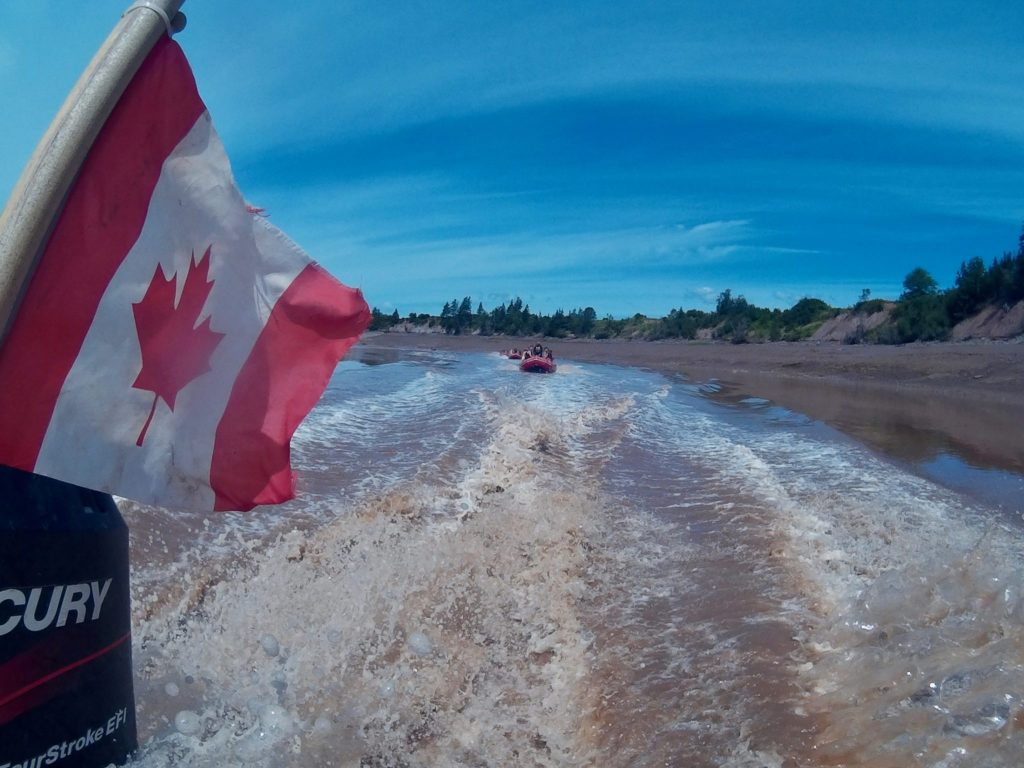 Canadian flag flies riding out on the Shubenacadie River with River Runners to go tidal bore rafting