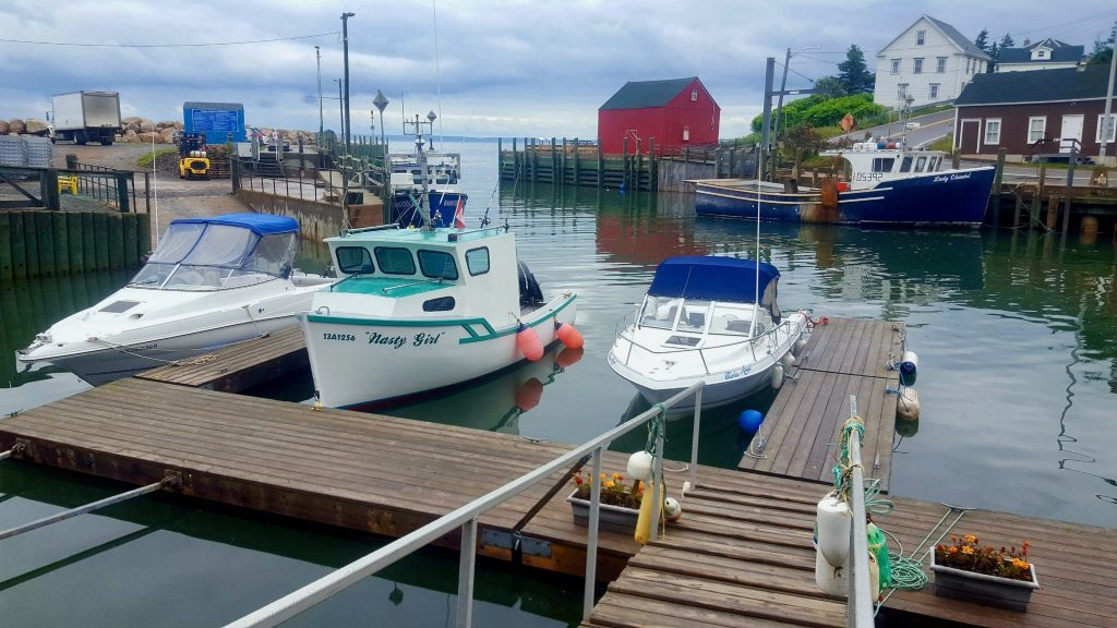 Hall's Harbour Nova Scotia boats floating at high tide in the harbour, which is part of the Bay of Fundy and the most extreme tides in the world