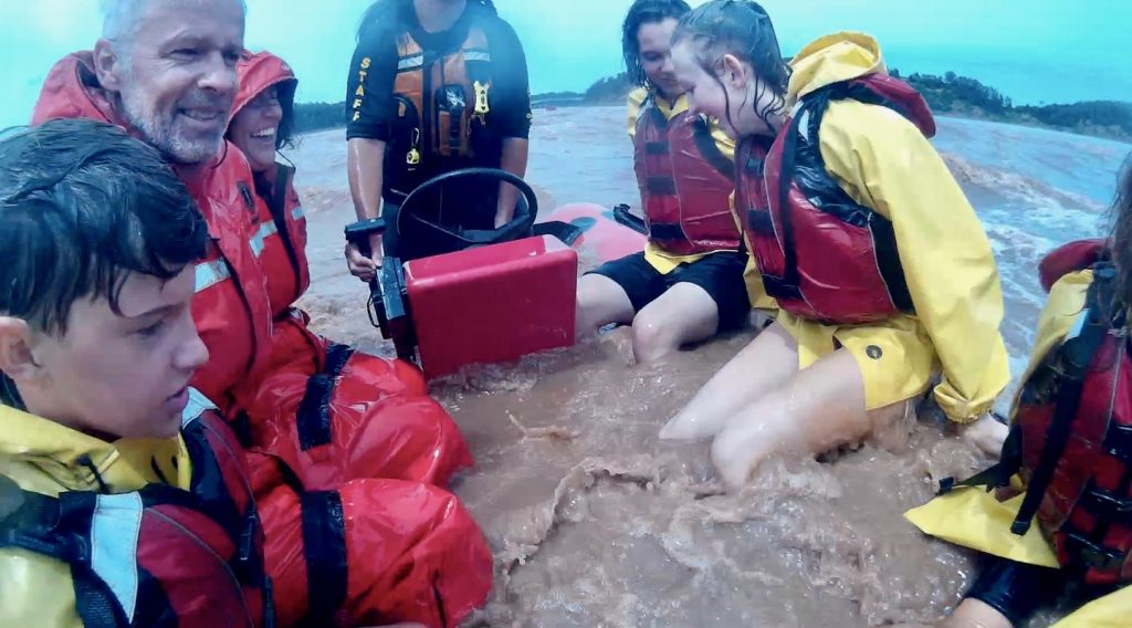 zodiac filled with river water while tidal bore rafting in nova scotia
