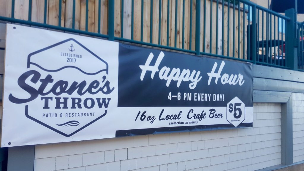 Stone's Throw Halifax Happy Hour sign: 16 oz craft beer 4-6 every day