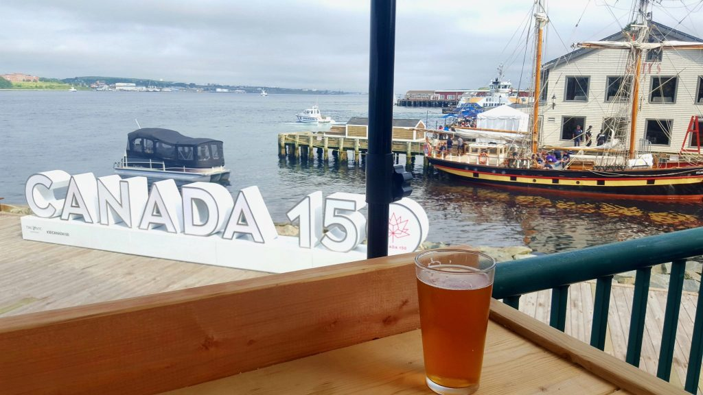Stone's Throw Halifax patio with beer on the Halifax waterfront boardwalk