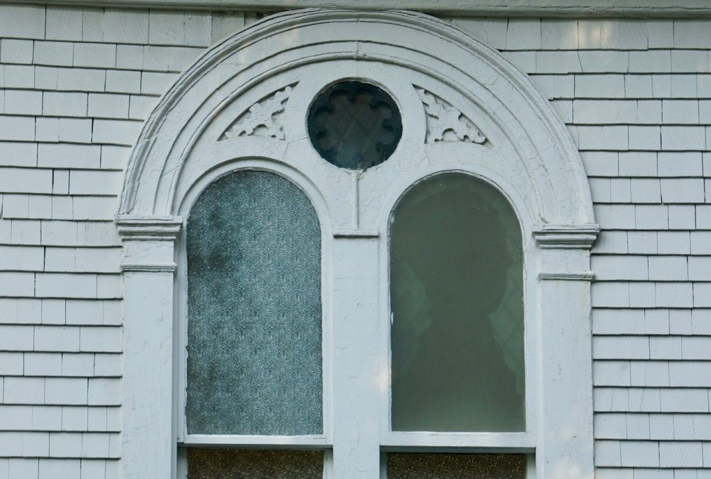 silhouette of man from Halifax Explosion in church window