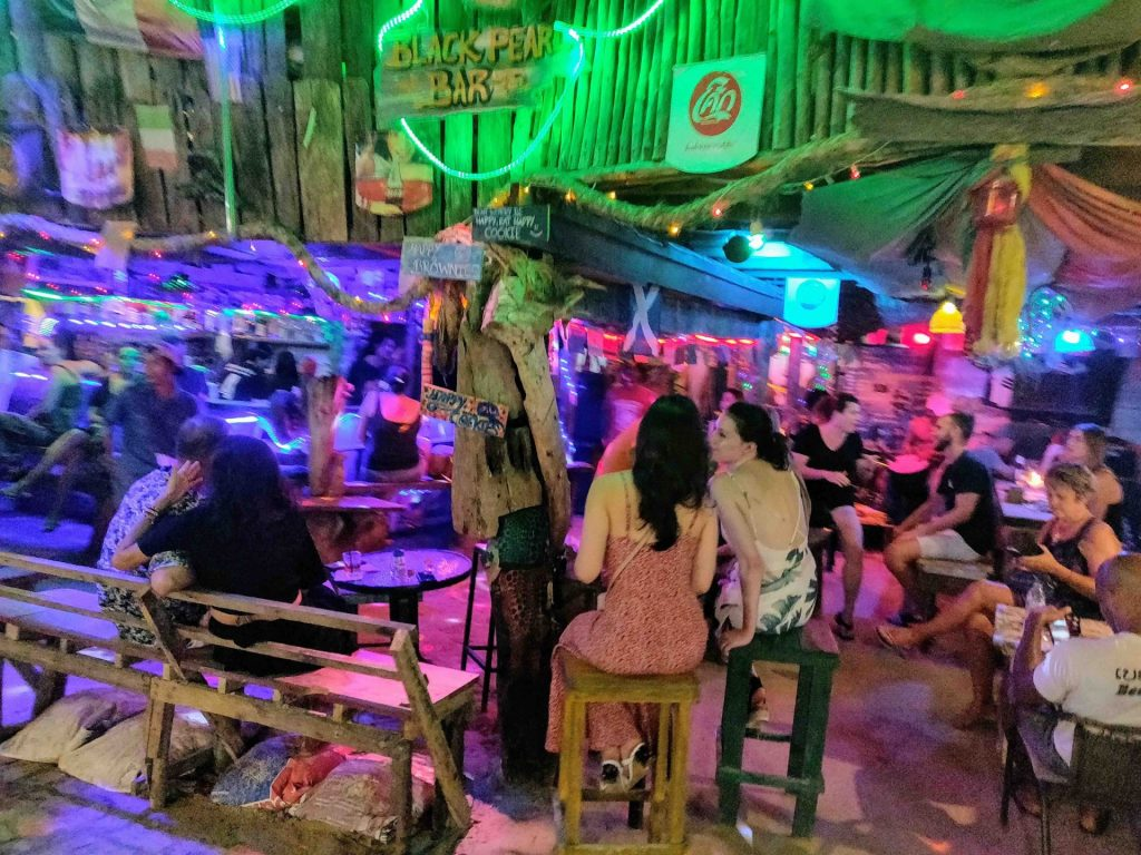 People at a casual bar in Railay at night