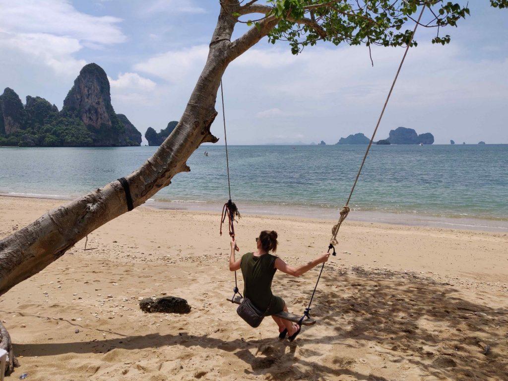Heather swings on a swing at Ton Sai Beach