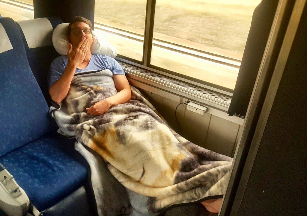 Sleeping on Amtrak Empire Builder coach class seats isn't completely comfortable but has good leg room
