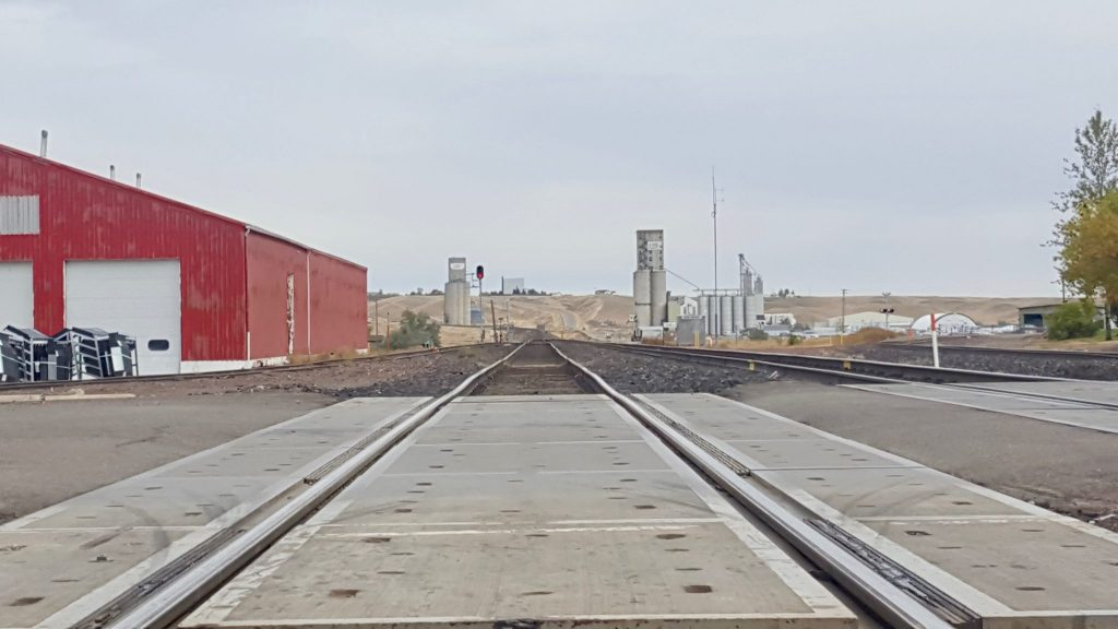 train tracks going through Midwestern town along the Amtrak Empire Builder route