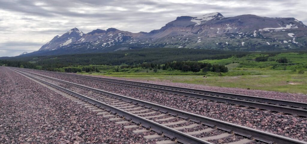 Amtrak Empire Builder train tracks in Montana mountains