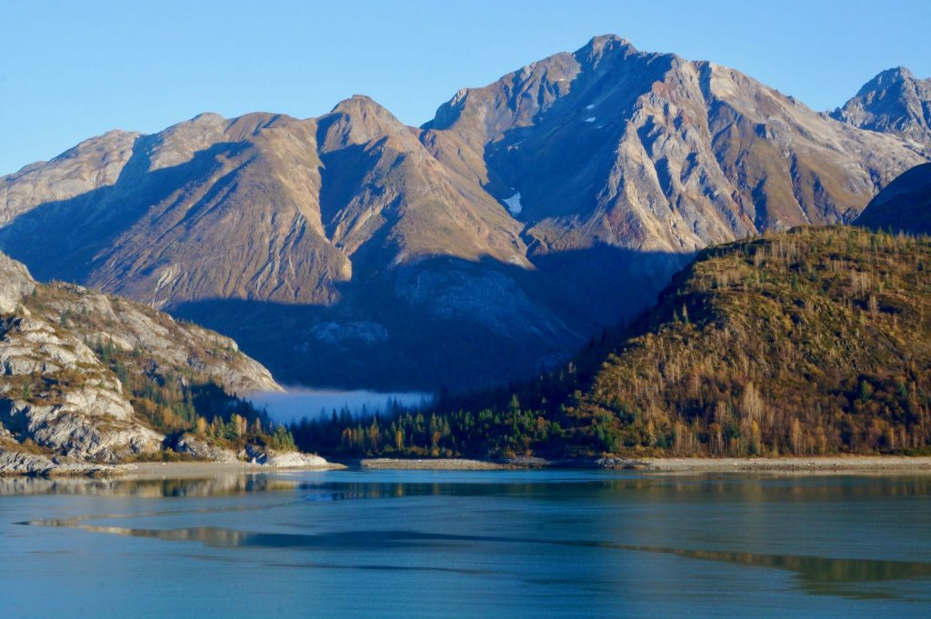 Morning fog in Glacier Bay revealing the mountains