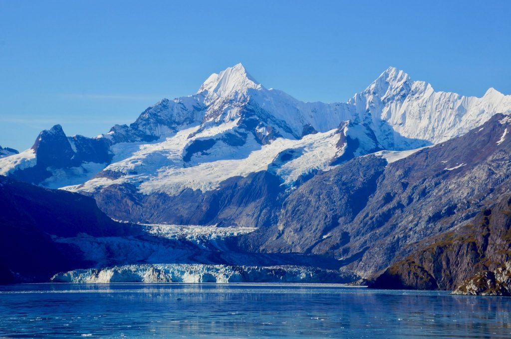 Lamplugh Glacier and snow-capped mountains in Glacier Bay National Park Alaska