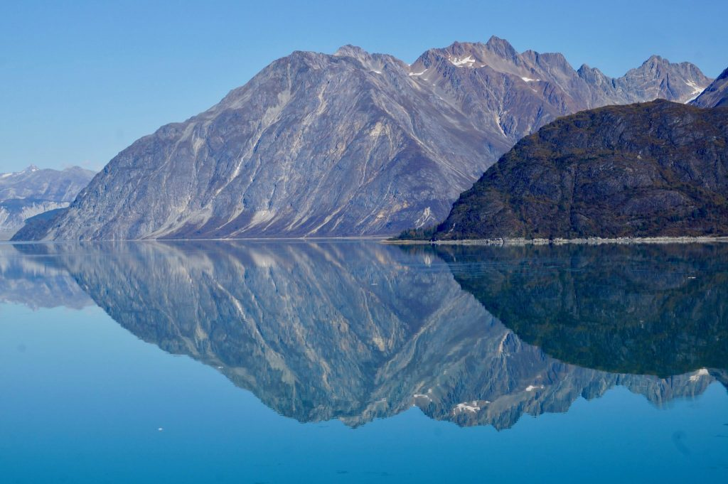 Glacier Bay National Park mountains reflecting into the calm bay waters
