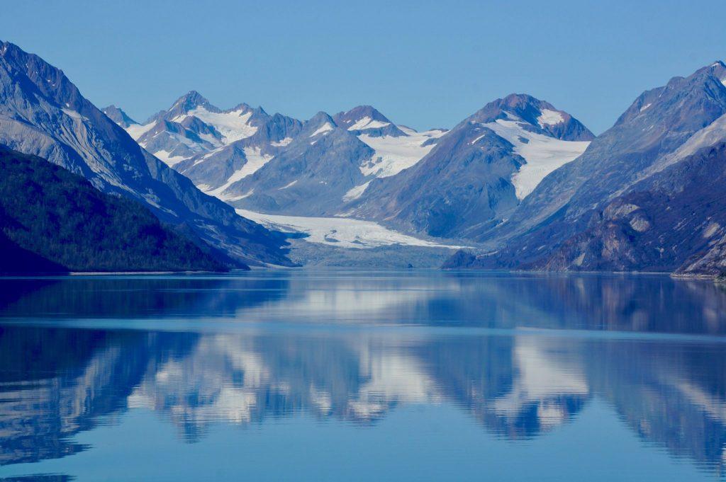 Alaska mountains reflecting into water of Glacier Bay