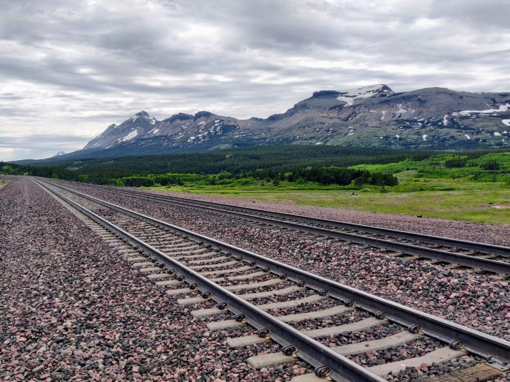 Empire Builder train tracks into Glacier National Park