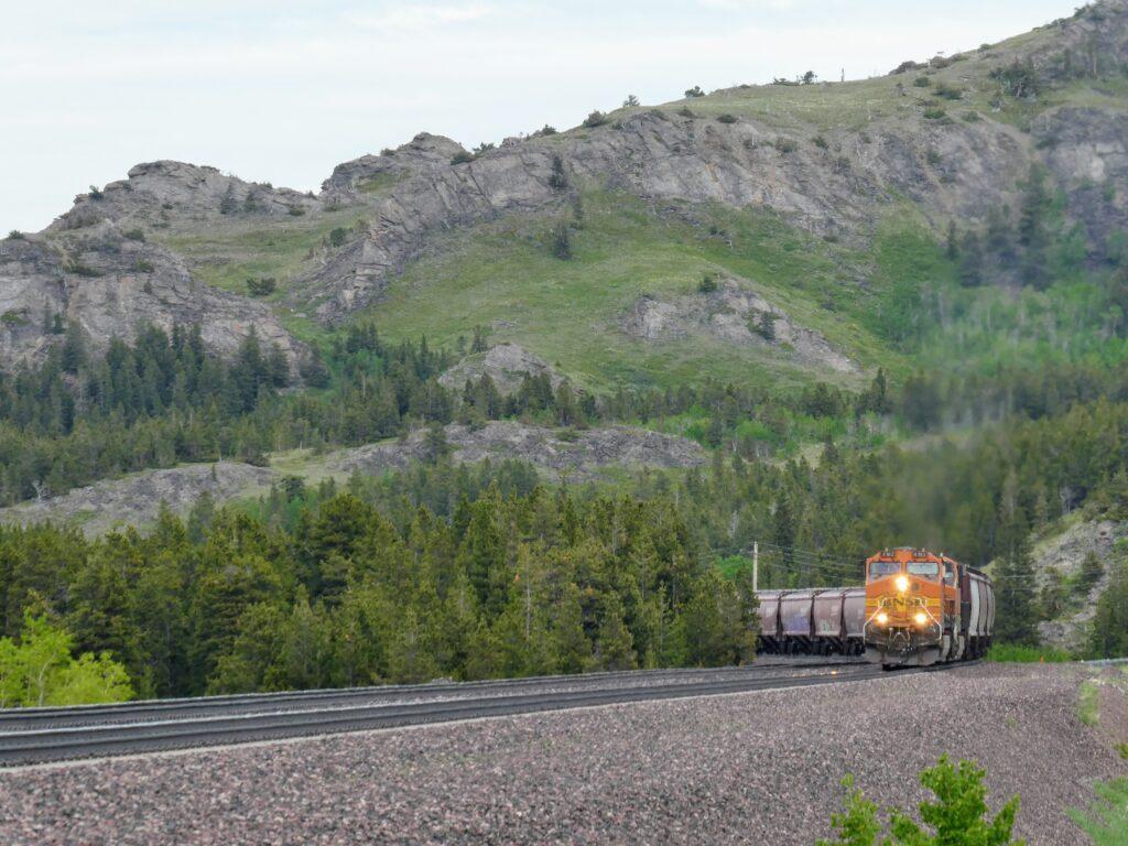 Train passes by Glacier National Park on Empire Builder route