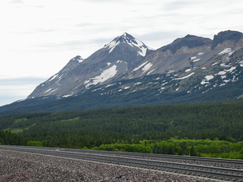 Glacier National Park rocky mountains passengers can see from the Amtrak Empire Builder train across US