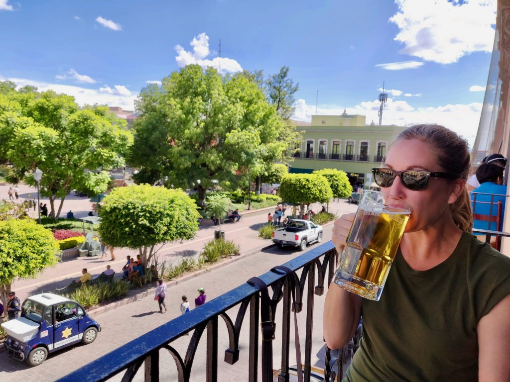 drinking a beer in Queretaro overlooking garden zenea at Corregidora
