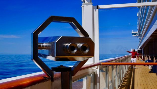 Binoculars on a cruise searching the ocean