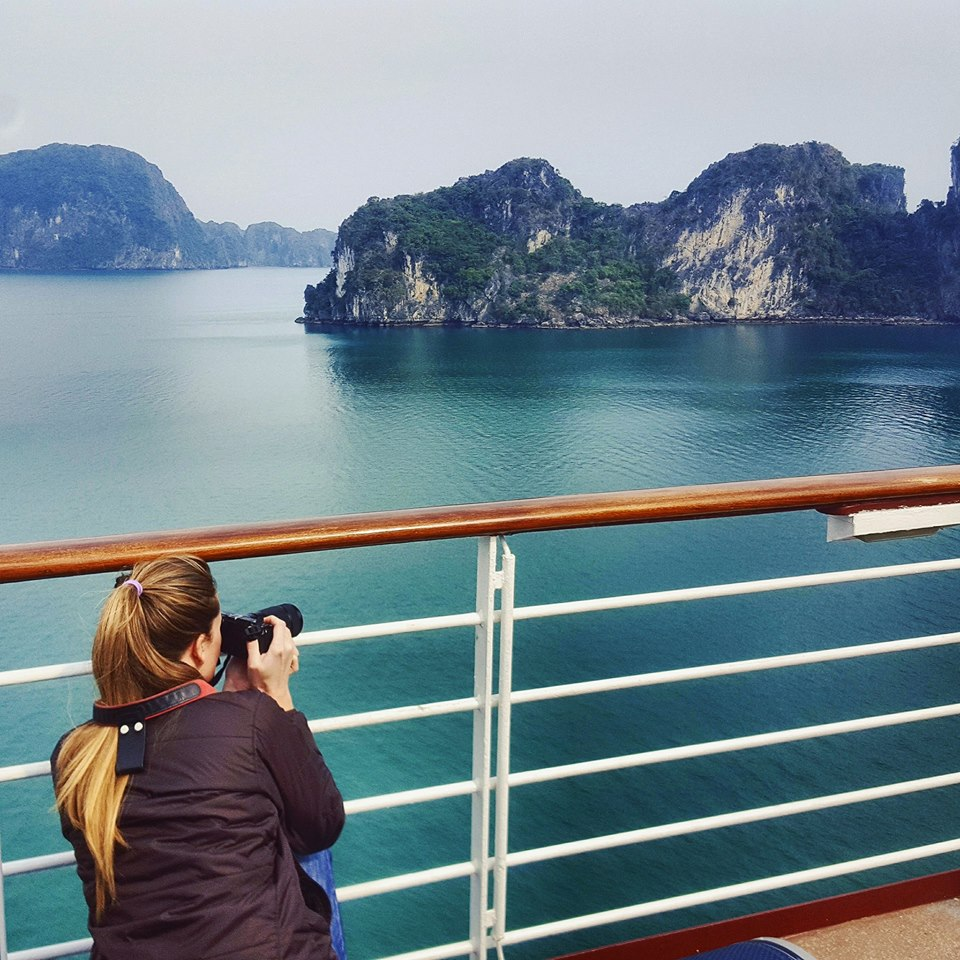 Taking photos of Ha Long Bay from aboard the Celebrity Millennium as part of our cheap world cruise
