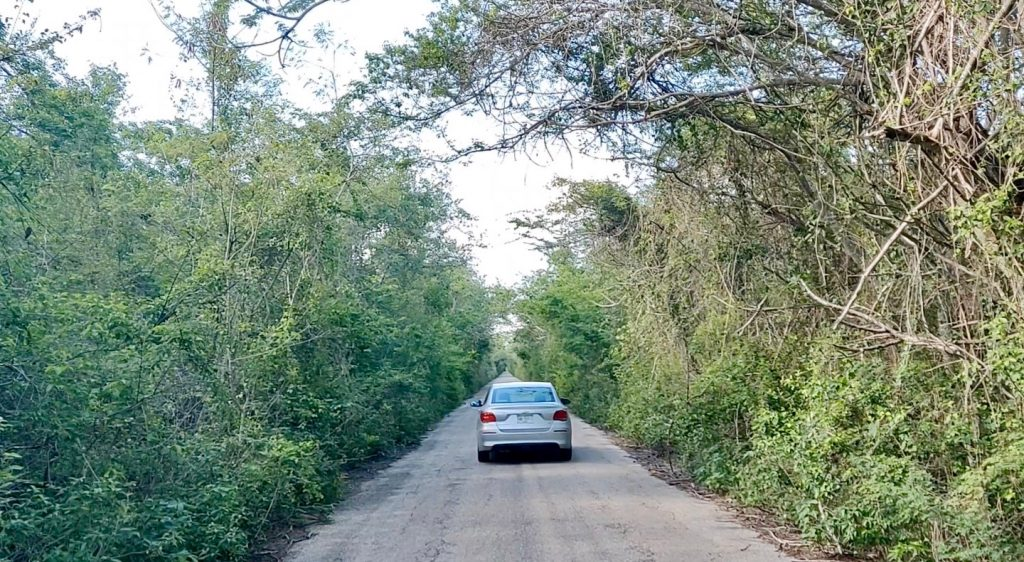 rental car driving down Ruta Puuc road in Yucatan Mexico